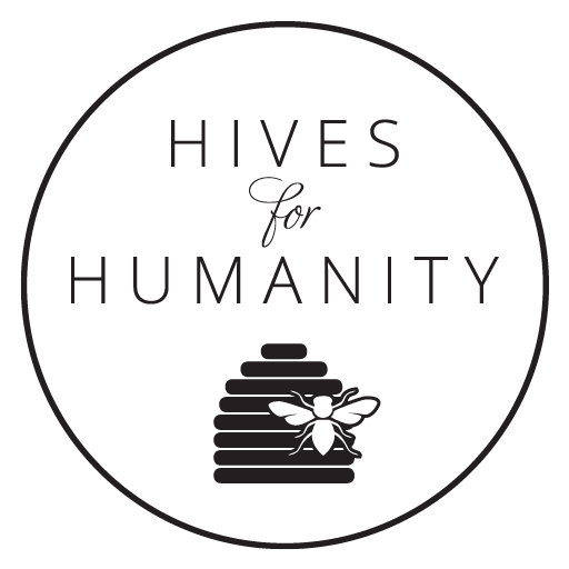 """black text on a white background reads """"Hives for Humanity"""" with a black beehive and white outline of a bee at the bottom, all within a black outline of a circle"""